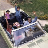 African-American Family Father Mother Son Daughter Waving from Convertible Car Outdoor 1970s