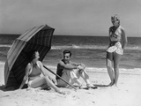 1930s Two Women 1 Man Sitting under Beach Umbrella Wearing Fashionable Swimwear