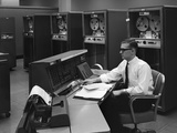 1960s Man in Shirt Tie and Thick Black Glasses Working with Ibm Data Processing System