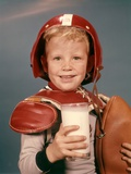 1960s Boy Wearing Red Helmet Football Shoulder Pads Holding Glass Milk and Football