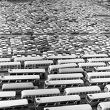 1960s Aerial of Crowded Stadium Parking Lot with Separate Sections for Buses and Cars