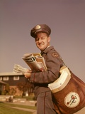 1960s Mailman Holding Mail Mailbag Letters Leather Mailbag in Suburban Neighborhood