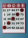 1960s Bingo Card with Red Markers in a Winning Game