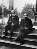1890s-1900s Two Bearded Men in Suits Holding Bowler Hats Sitting on Stairs in Front of House