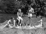1930s Two Couples Having Summer Picnic with Food and Drink Spread Out on Blanket