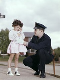 1960s Man Police Officer Comforting Crying Scared Little Lost Girl in Suburban Neighborhood