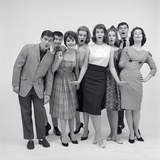 1960s 8 Fashionable Teens Standing Full Length Looking Amazed