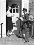 1930s Postman Giving a Letter to a Woman in the Doorway of a Colonial Brick Home