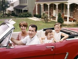 1960s Suburban Family Sitting in Red Ford Convertible Mustang