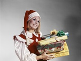 1960s Young Woman in Red and White Santa Helper Costume and Hat Holding Pile of Wrapped Christmas