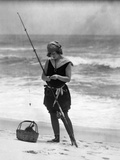 1920s Woman in Bathing Suit Costume Standing on Beach Putting Bait on Surf Fishing Pole