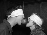 1950s Blindfolded Couple Trying to Eat an Apple Hanging in Air from a String Inside