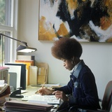 1960s-1970s African-American Woman Sit at Desk Write on Papers