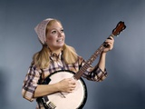 1960s Young Blonde Woman Wearing Plaid Shirt Playing Banjo Singing Folk Music