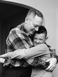1950s-1960s Father and Son Hugging Indoor