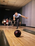 1960s Man in Good Form Releasing Bowling Ball Down Lane Wife Woman 2 Kids Behind Him