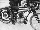 Motorcyclist Holding Rudge Motorcycle