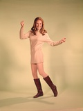 1960s Woman Dancer in Tan Dress and Boots White Fishnet Stockings