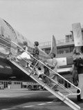 1950S Family Boarding Propeller Airliner by Climbing Gangway Stairs at Airport