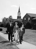 1960s Family Walking from Church on Suburban Sidewalk
