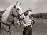 1950s Teenage Girl Western Wear Holding Horse Halter Drinking Carbonated Beverage from Bottle