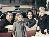 1950s Portrait Family Father Mother Son Daughter Sitting in Red White Convertible Automobile