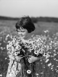 1920s Girl in Meadow Holding Bunch of Daisies