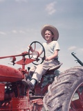 1950s Farm Boy Wearing Straw Hat and Driving Tractor