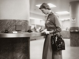 1950s-1960s Woman Handbag on Arm Gloves Filling Out Deposit Slip Bank Counter
