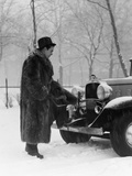 1930s Man in Hat and Raccoon Fur Coat Standing Foot on Bumper of Chevrolet Roadster Stalled