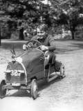 1930s Boy Driving Home Built Race Car Holding Steering Wheel