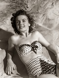 1950s Brunette Woman Wear Polka Dot Two Piece Bathing Suit Laying on Sand