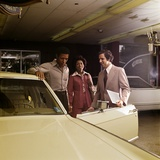 1970s African-American Couple with Salesman Automobile Showroom