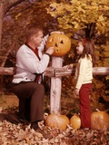 1960s Man Father and Girl Daughter Carving Halloween Jack-O-Lantern Pumpkin