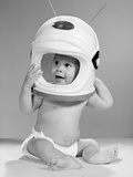 1960s Baby in Diaper Seated Holding Astronaut Helmet with Antennae on Head