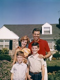 1960s Portrait Family Father Mother Two Sons Standing Together in Front of Suburban House