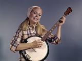 1960s Young Blonde Woman Wearing Plaid Shirt Playing Banjo Singing Folk Music Looking at Camera