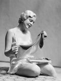 1930s Woman in Silk Teddy Lingerie Opening a Box of Hosiery
