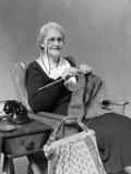 1930s Elderly Woman Wearing Pince-Nez Glasses Sitting Knitting