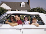 1960s Father and Mother with Son and Daughter Sitting in White Four Door Sedan Automobile