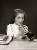 1950s-1960s School Girl Using Straw Drinking Carbonated Beverage from Bottle