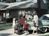 1950s-1960s Suburban Family Loading Ford Four Door Sedan Automobile for Trip