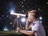 1960s Composite Boy with Telescope on Table Looking at Night Sky with Stars Galaxy Nebula