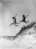 1920s-1930s Two Girls Midair Jumping Off of Beach Sand Dune
