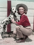 1940s-1950s Smiling Woman Wearing Western Cowgirl Outfit Kneeling Petting Dalmatian Dog