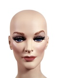 Symbolic Portrait of Woman Mannequin Head Without Hair 1970s Style Make-Up Studio Indoor