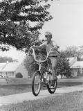 1970s Boy Riding Bike Suburban Sidewalk