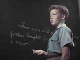 1950s Boy with Freckles at History Class Blackboard Writing Gettysburg Address with Chalk