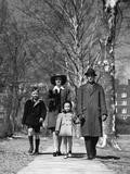 1930s-1940s Family Walking Forward Winter Suburban Sidewalk