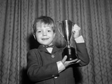 1950s Proud Boy Holding Up Trophy Award